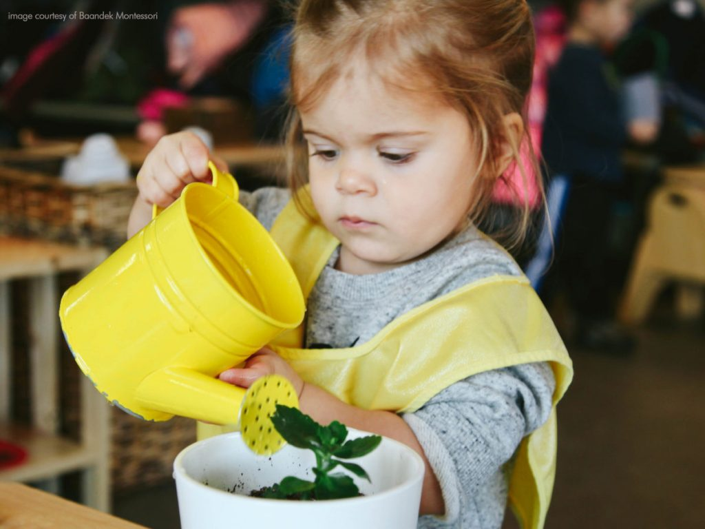 Child Watering plant